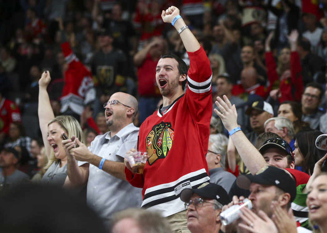 A Chicago Blackhawks fan celebrates a goal against the Golden Knights during an NHL hockey game at T-Mobile Arena in Las Vegas on Tuesday, Oct. 24, 2017. Chase Stevens Las Vegas Review-Journal @cs ...