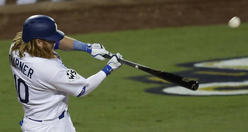 Los Angeles Dodgers' Justin Turner hits a two-run home run during the sixth inning of Game 1 of baseball's World Series against the Houston Astros Tuesday, Oct. 24, 2017, in Los Angeles. (AP Photo ...