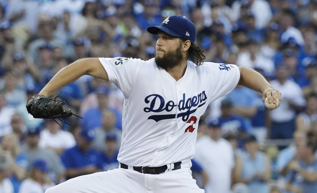 Los Angeles Dodgers starting pitcher Clayton Kershaw throws during the first inning of Game 1 of baseball's World Series against the Houston Astros Tuesday, Oct. 24, 2017, in Los Angeles. (AP Phot ...
