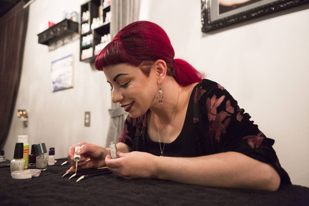 Nail artist Andrea Lipomi demonstrates a halloween nail design of a ghost in her salon, Feetish Spa Parlor in Emergency Arts in Las Vegas, Wednesday, Oct 25, 2017. Elizabeth Brumley Las Vegas Revi ...