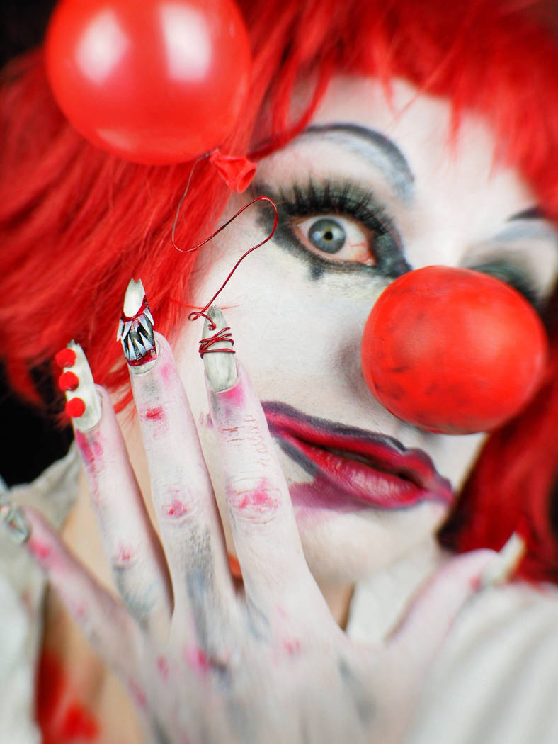 "Andrea Lipomi models nails inspired by the movie ""IT."" Photo by Ginger Bruner."