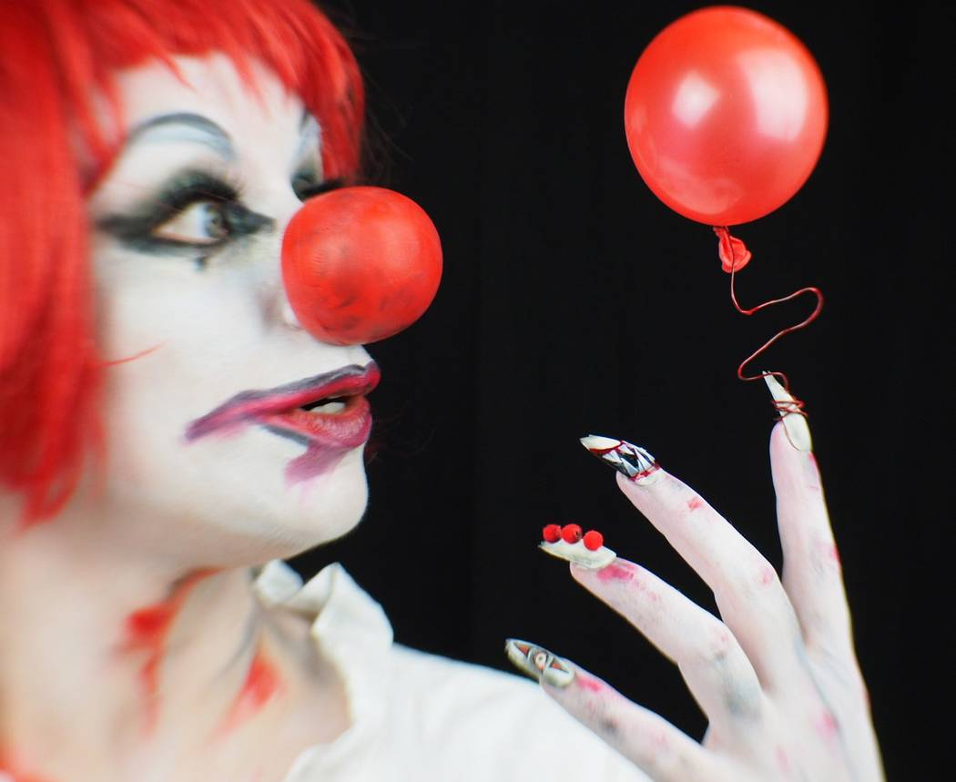 """Andrea Lipomi models nails inspired by the movie """"IT."""" Photo by Ginger Bruner."""