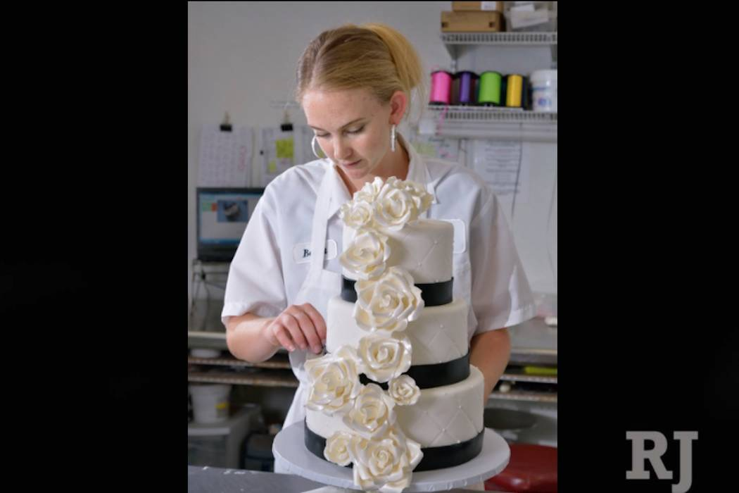 Barret Carpenter works on a wedding cake at Freed's Bakery in Las Vegas on Thursday, July 3, 2014. (Bill Hughes/Las Vegas Review-Journal)
