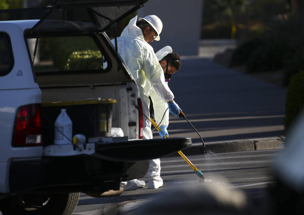 A hazardous materials cleanup crew works near the Route 91 music festival grounds along Las Vegas Boulevard near Reno Avenue in Las Vegas on Tuesday, Oct. 3, 2017. A gunman opened fire on attendee ...