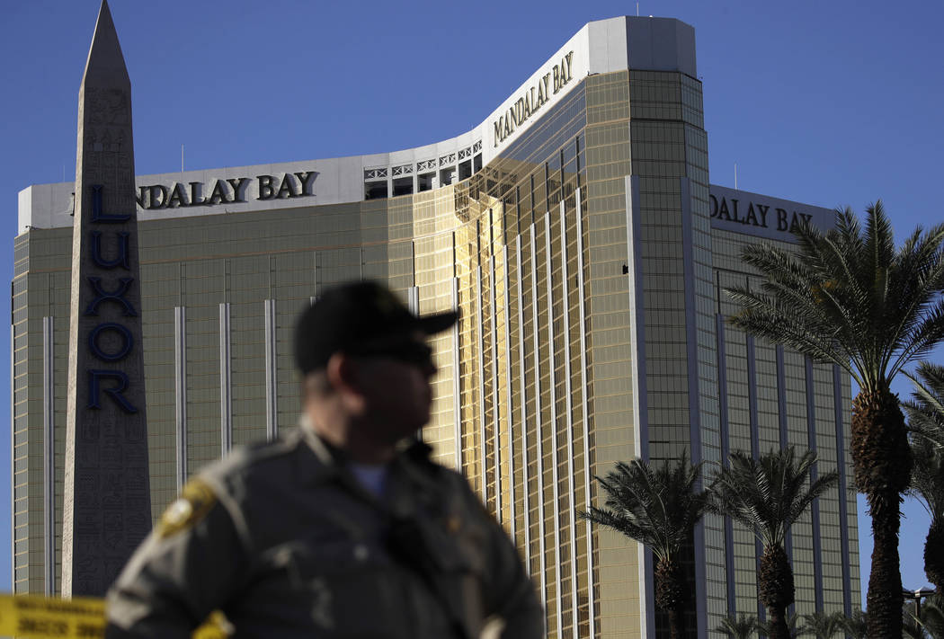 In this Oct. 3, 2017, file photo, a Las Vegas police officer stands by a blocked off area near the Mandalay Bay casino in Las Vegas. John Locher/The Associated Press