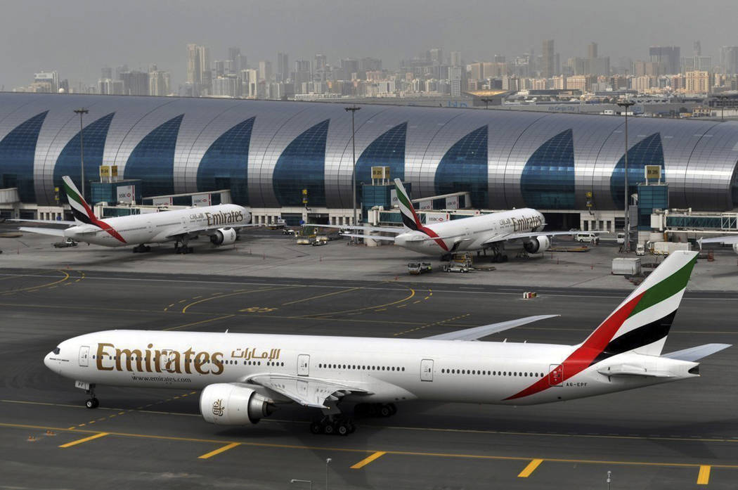 An Emirates plane taxis to a gate at Dubai International Airport at Dubai International Airport in Dubai, United Arab Emirates on Wednesday, March 22, 2017. (Adam Schreck/AP)