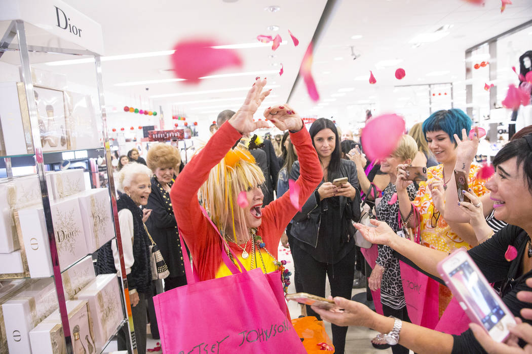 Fashion icon Betsey Johnson, left, throws rose pedals to fans at Macy's en route to a meet and greet on Saturday, October 21, 2017, at Fashion Show Mall, in Las Vegas. Benjamin Hager Las Vegas Rev ...