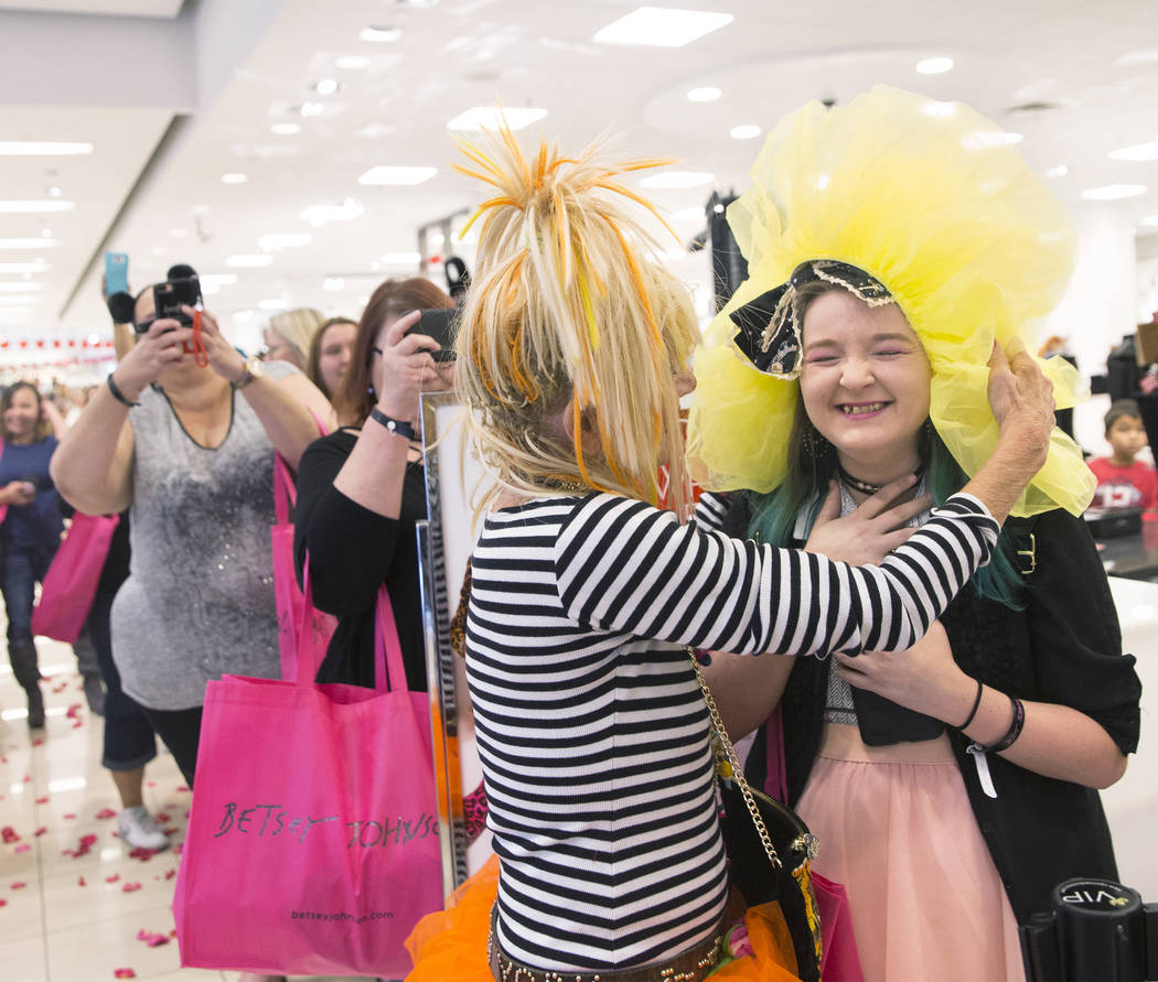 Fashion icon Betsey Johnson, left, gives one of her tutu's to Evangeline Lafey during a meet and greet on Saturday, October 21, 2017, at Macy's Fashion Show, in Las Vegas. Benjamin Hager Las Vegas ...