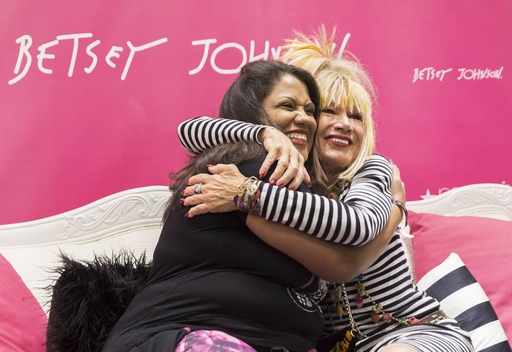 Fashion icon Betsey Johnson, right, hugs Danielle Fields during a meet and greet on Saturday, October 21, 2017, at Macy's Fashion Show, in Las Vegas. Benjamin Hager Las Vegas Review-Journal @benja ...
