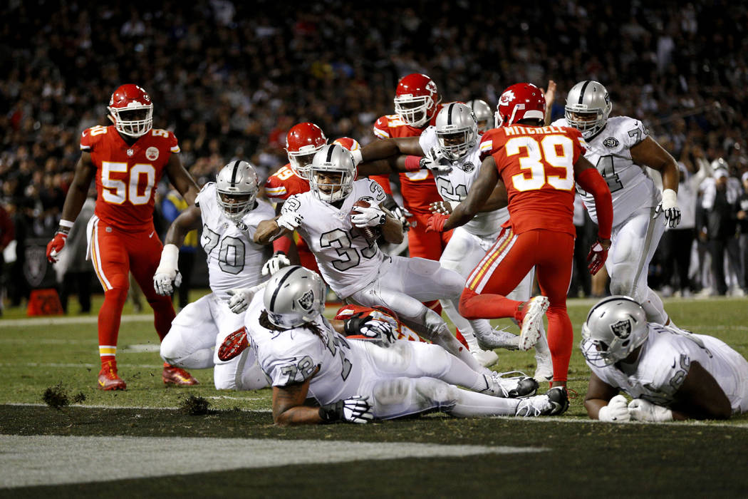 Oct 19, 2017; Oakland, CA, USA; Oakland Raiders running back DeAndre Washington (33) scores a touchdown against the Kansas City Chiefs in the third quarter at Oakland Coliseum. The Raiders defeate ...