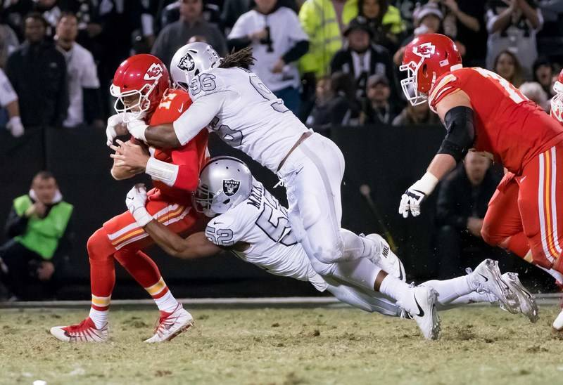 Oct 19, 2017; Oakland, CA, USA; Oakland Raiders defensive end Khalil Mack (52) and defensive end Denico Autry (96) combing to sack Kansas City Chiefs quarterback Alex Smith (11) during the fourth  ...