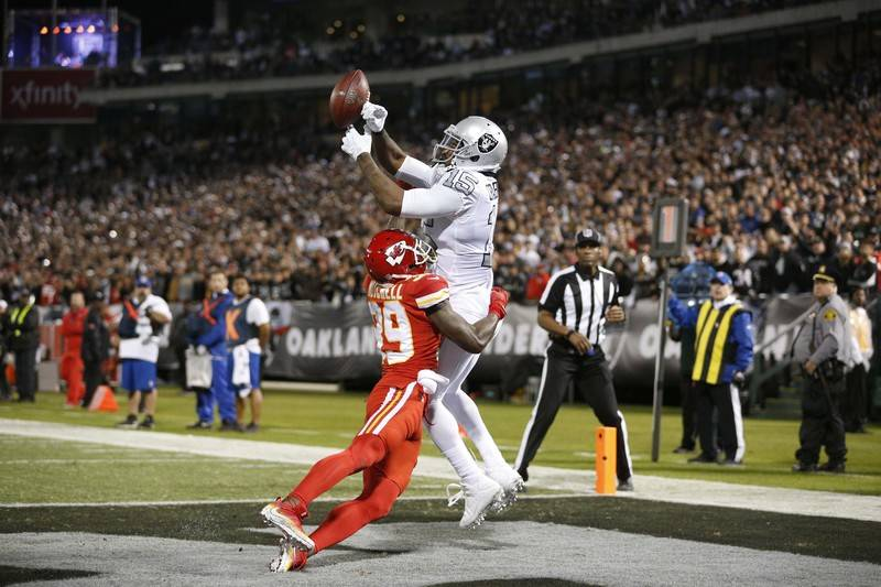 Oct 19, 2017; Oakland, CA, USA; Oakland Raiders wide receiver Michael Crabtree (15) is unable to make a catch in the end zone over the top of Kansas City Chiefs cornerback Terrance Mitchell (39) i ...