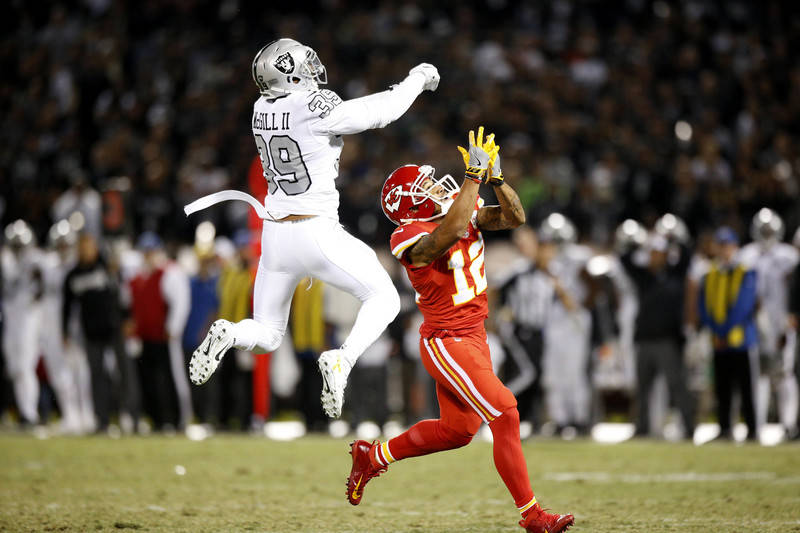 Oct 19, 2017; Oakland, CA, USA; Kansas City Chiefs wide receiver Albert Wilson (12) prepares to catch a touchdown off a deflected pass by Oakland Raiders strong safety Keith McGill (39) in the thi ...