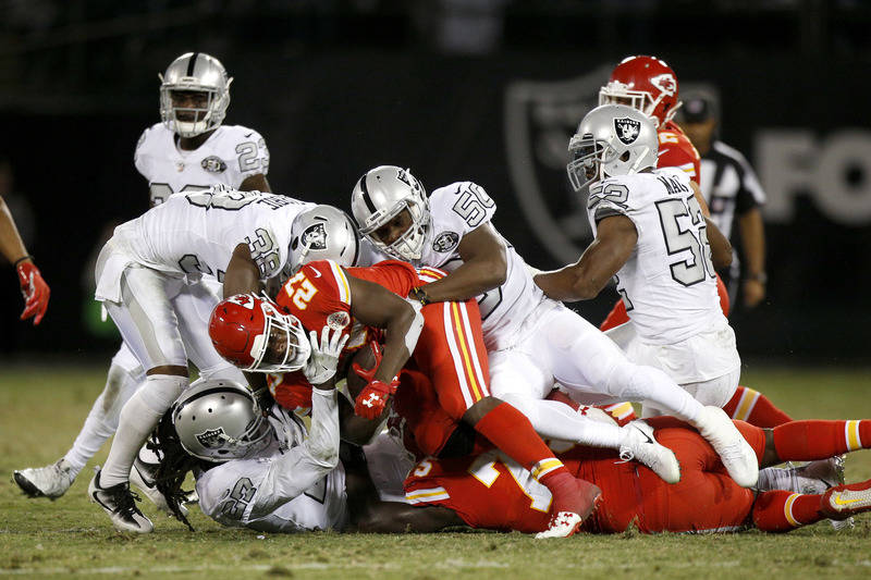 Oct 19, 2017; Oakland, CA, USA; Kansas City Chiefs running back Kareem Hunt (27) is tackled by Oakland Raiders linebacker Nicholas Morrow (50) in the fourth quarter at Oakland Coliseum. The Raider ...