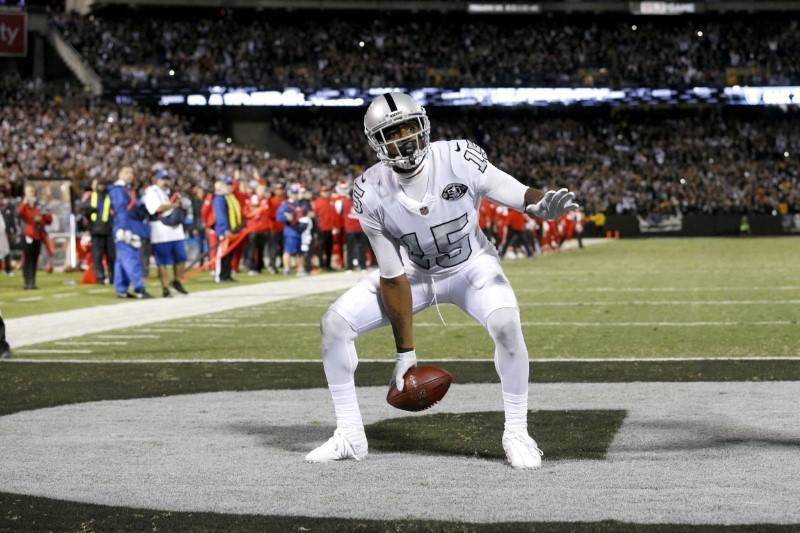 Oct 19, 2017; Oakland, CA, USA; Oakland Raiders wide receiver Michael Crabtree (15) reacts after catching a pass in the end zone against the Kansas City Chiefs in the fourth quarter at Oakland Col ...