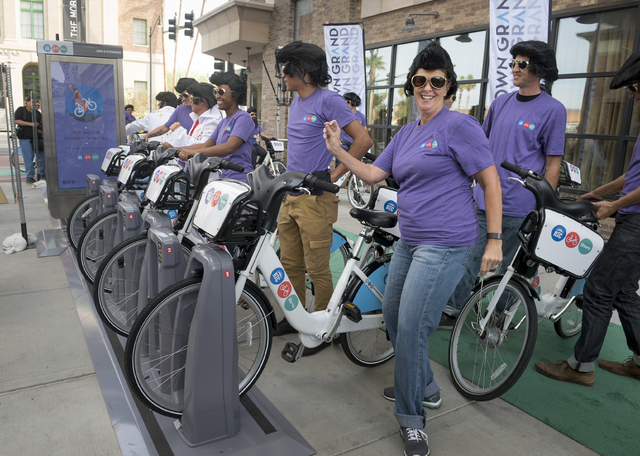 """Cycling Elvis Kathleen Kahr dances to """"Viva Las Vegas"""" after parking her bike as the Regional Transportation Commission of Southern Nevada (RTC) celebrates the launch of RTC Bike ..."""