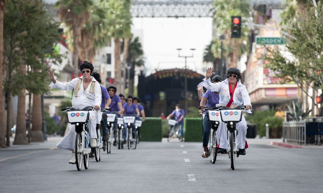 Cycling Elvises arrive in formation as the Regional Transportation Commission of Southern Nevada (RTC) celebrates the launch of RTC Bike Share in downtown Las Vegas on Thursday, Oct. 27, 2016.  RT ...