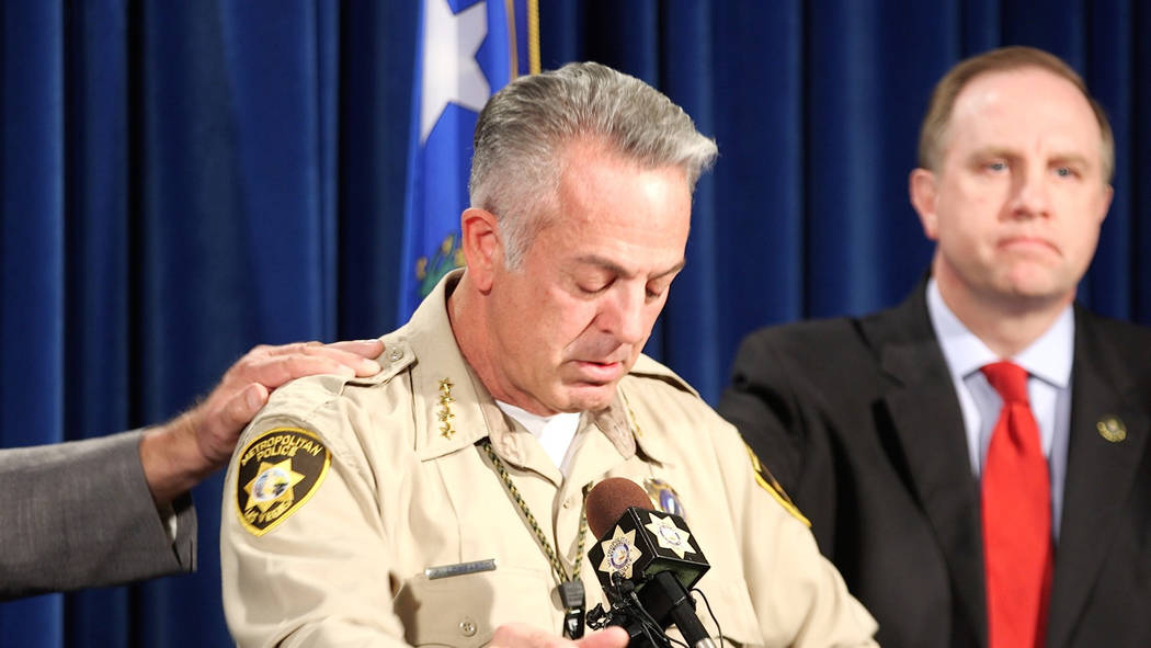 Clark County Sheriff Joe Lombardo, left, gets emotional during a news conference at the Metropolitan Police Department in Las Vegas on Oct. 13, 2017, with FBI Special Agent in Charge Aaron Rouse.  ...