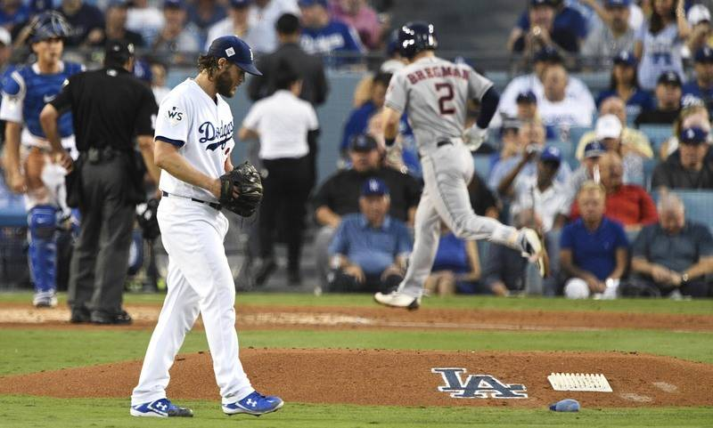 Oct 24, 2017; Los Angeles, CA, USA; Los Angeles Dodgers starting pitcher Clayton Kershaw (22) reacts as Houston Astros third baseman Alex Bregman (2) runs in a home run in the fourth inning in gam ...