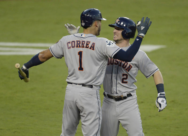 Oct 24, 2017; Los Angeles, CA, USA; Houston Astros third baseman Alex Bregman (2) celebrates with shortstop Carlos Correa (1) after hitting a solo home run in the fourth inning in game one of the  ...