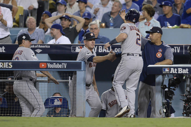 Oct 25, 2017; Los Angeles, CA, USA; Houston Astros third baseman Alex Bregman (2) is welcomed back to the dugout after scoring a run against the Los Angeles Dodgers in the 8th inning in game two o ...