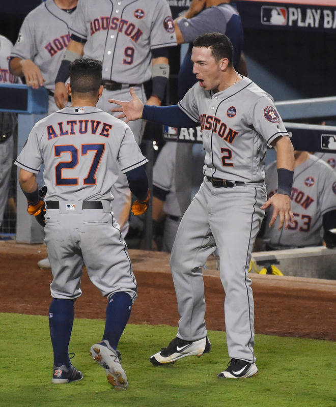 Oct 25, 2017; Los Angeles, CA, USA; Houston Astros second baseman Jose Altuve (27) celebrates with third baseman Alex Bregman (2) after hitting a solo home run against the Los Angeles Dodgers in t ...