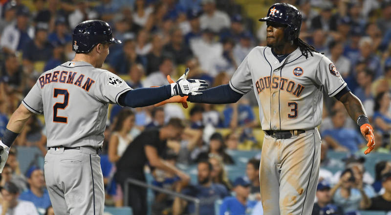 Oct 25, 2017; Los Angeles, CA, USA; Houston Astros center fielder Cameron Maybin (3) celebrates with third baseman Alex Bregman (2) after scoring in the eleventh inning against the Los Angeles Dod ...
