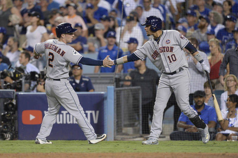 Oct 25, 2017; Los Angeles, CA, USA; Houston Astros third baseman Alex Bregman (2) celebrates with first baseman Yuli Gurriel (10) after scoring a run against the Los Angeles Dodgers in game two of ...