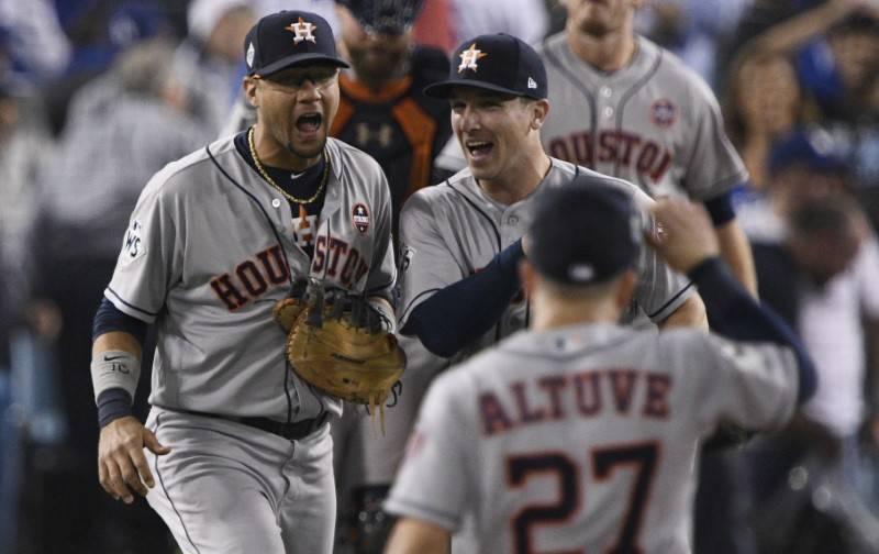 Oct 25, 2017; Los Angeles, CA, USA; Houston Astros second baseman Jose Altuve (27) celebrates first baseman Yuli Gurriel (10) and third baseman Alex Bregman (2) after the Houston Astros defeated t ...