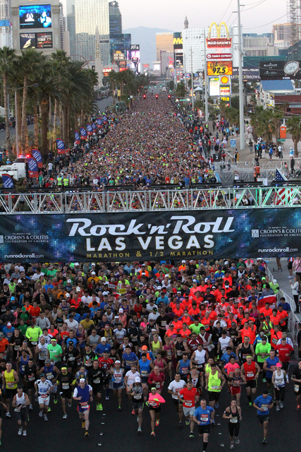 Runners cross the starting line at the start of the Rock ծՠRoll Las Vegas Marathon and Half-Marathon on the Strip Sunday, Nov. 17, 2013. (K.M. Cannon/Las Vegas Review-Journal)