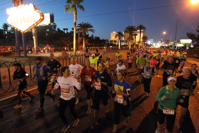 Runners head north and south at the Welcome to Las Vegas sign during the Rock ծՠRoll Las Vegas Marathon and Half-Marathon on the Strip Sunday, Nov. 17, 2013. (K.M. Cannon/Las Vegas Rev ...