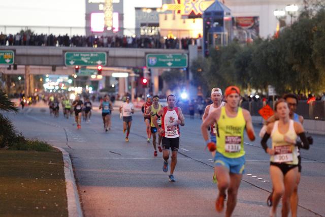 Runners compete during the Rock 'n' Roll marathon on the Strip near Monte Carlo casino-hotel in Las Vegas Sunday, Nov. 16, 2014. (Erik Verduzco/Las Vegas Review-Journal)