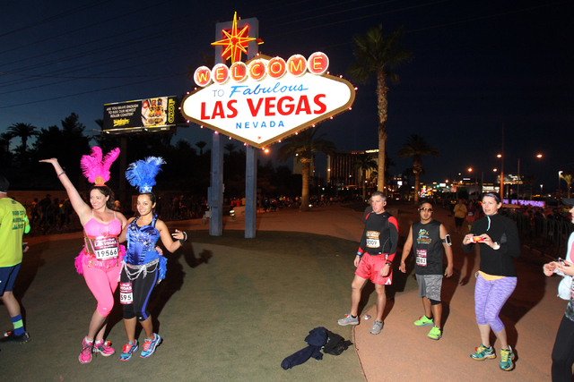 Runners pose in front of the Welcome to Las Vegas sign during the Rock 'n' Roll Las Vegas Marathon and half marathon on the Strip on Sunday, Nov. 16, 2014. (K.M. Cannon/Las Vegas Review-Journal)