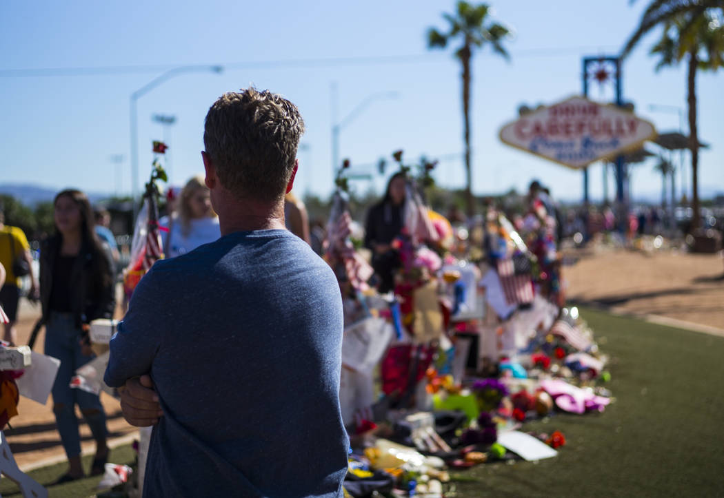 """Robert Patterson of Lomita, California, visits the makeshift memorial for his wife, Lisa Patterson, who was one of 58 people who died in the Oct. 1 shooting at a music festival, near the """"Welcome  ..."""