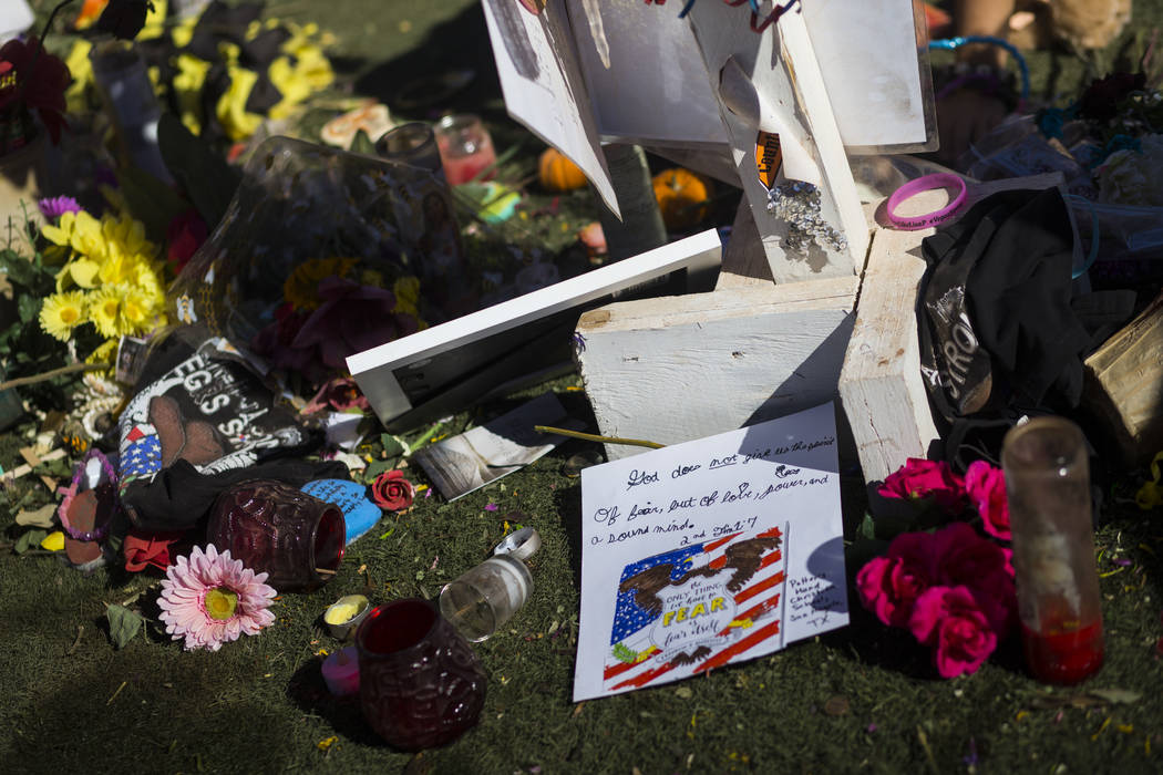 """Items left at a makeshift memorial for Lisa Patterson, who was one of 58 people who died in the Oct. 1 shooting at a music festival, near the """"Welcome to Fabulous Las Vegas"""" sign ..."""