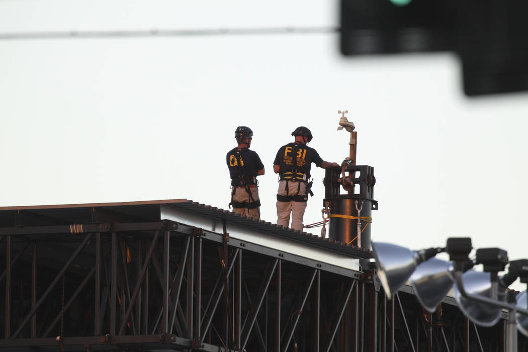The FBI investigates atop of the Route 91 Harvest main stage at the Las Vegas Village festival grounds, Wednesday, Oct. 11, 2017. Richard Brian Las Vegas Review-Journal @vegasphotograph