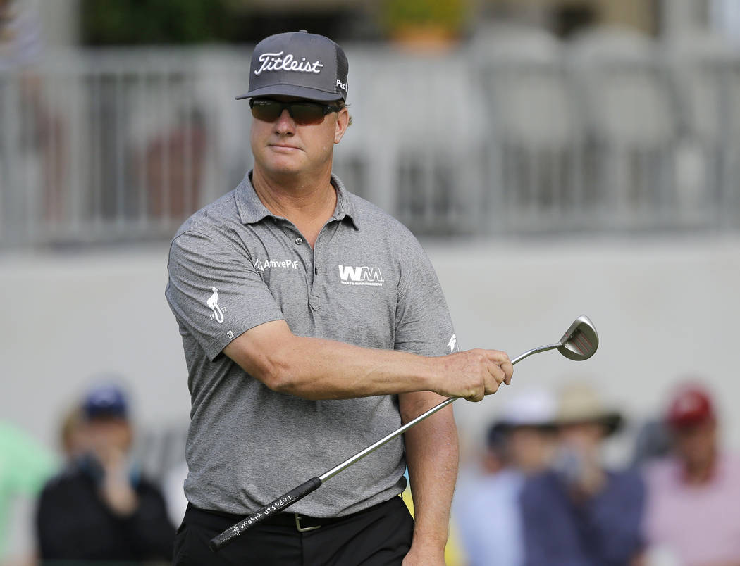 Charley Hoffman gestures left as he watches his putt on the 18th hole during the third round of the Bridgestone Invitational golf tournament at Firestone Country Club, Saturday, Aug. 5, 2017, in A ...