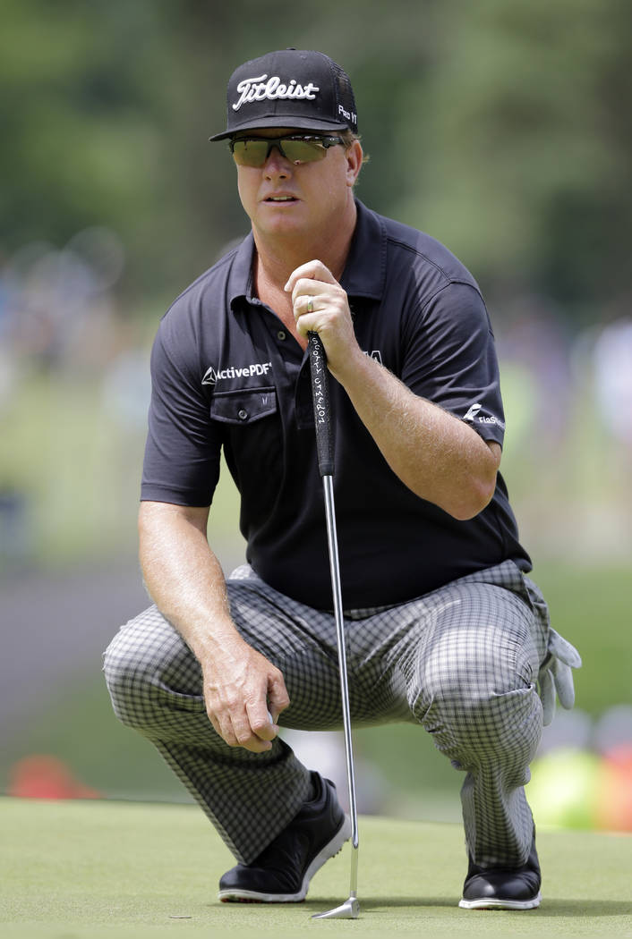 Charley Hoffman lines up his putt on the second green during the final round of the Bridgestone Invitational golf tournament at Firestone Country Club, Sunday, Aug. 6, 2017, in Akron, Ohio. (AP Ph ...