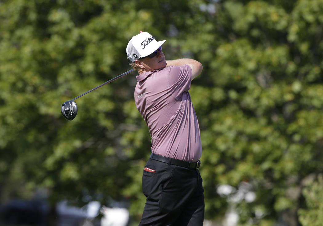 Charley Hoffman watches his tee shot on the fourth hole during the second round of the BMW Championship golf tournament at Conway Farms Golf Club, Friday, Sept. 15, 2017, in Lake Forest, Ill. (AP  ...