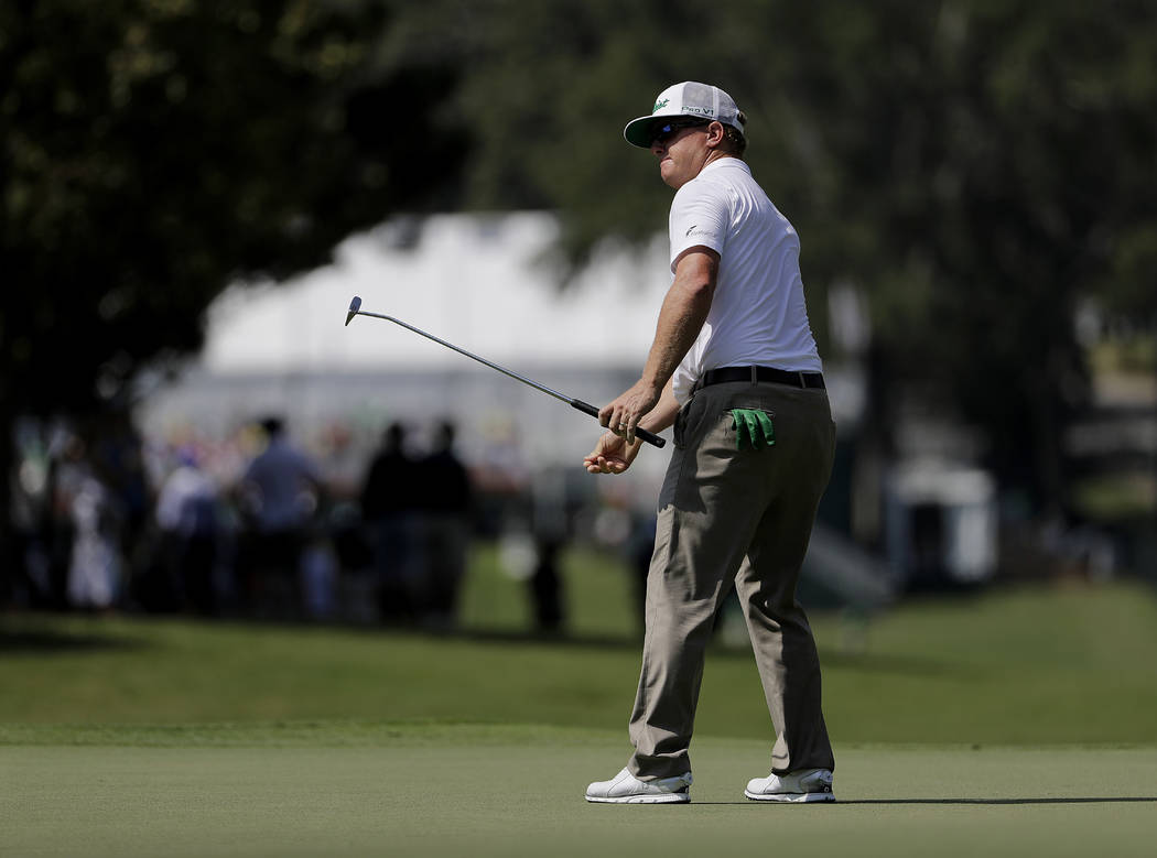 Charley Hoffman putts on the first hole during the first round of the Tour Championship golf tournament at East Lake Golf Club in Atlanta, Thursday, Sept. 21, 2017. (AP Photo/David Goldman)