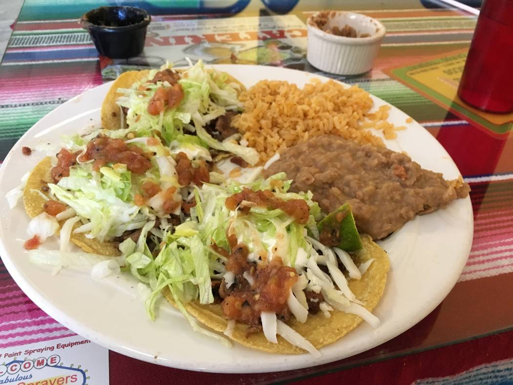 A plate of tacos al pastor served alongside rice and beans at Chile Caliente on Oct. 27. (Diego Mendoza-Moyers/View) @dmendozamoyers