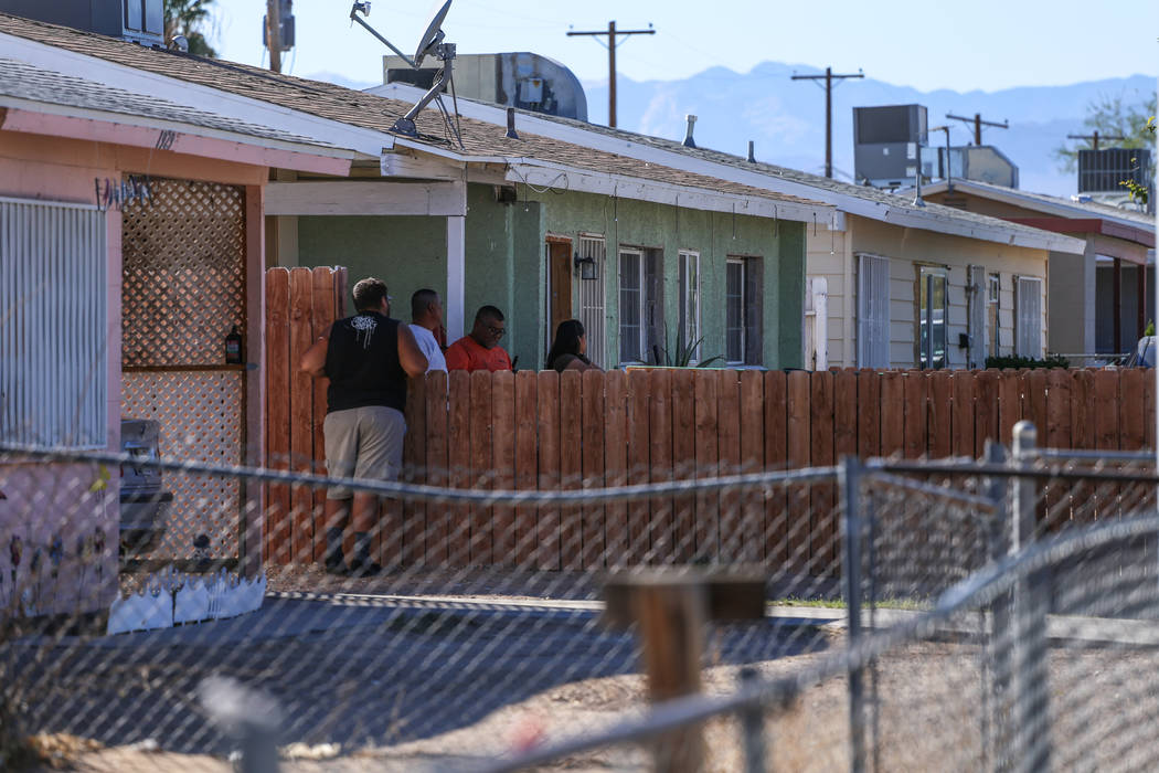 Neighbors watch a homicide scene on Hassell Avenue near Comstock Drive in North Las Vegas, Friday, Oct. 27, 2017. Joel Angel Juarez Las Vegas Review-Journal @jajuarezphoto