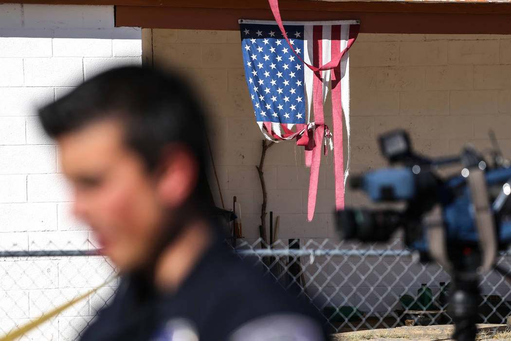 An American flag hangs nearby a homicide on Hassell Avenue near Comstock Drive in North Las Vegas, Friday, Oct. 27, 2017. Joel Angel Juarez Las Vegas Review-Journal @jajuarezphoto