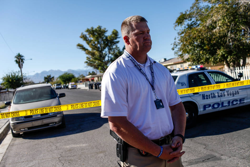 North Las Vegas Police spokesman Eric Leavitt briefs media at the scene of a homicide on Hassell Avenue near Comstock Drive in North Las Vegas, Friday, Oct. 27, 2017. Joel Angel Juarez Las Vegas R ...