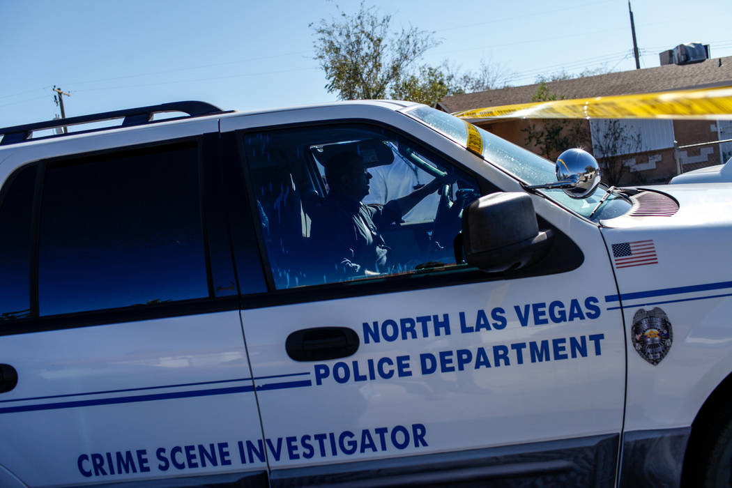 A Crime Scene Investigator vehicle drives to a homicide scene on Hassell Avenue near Comstock Drive in North Las Vegas, Friday, Oct. 27, 2017. Joel Angel Juarez Las Vegas Review-Journal @jajuarezphoto