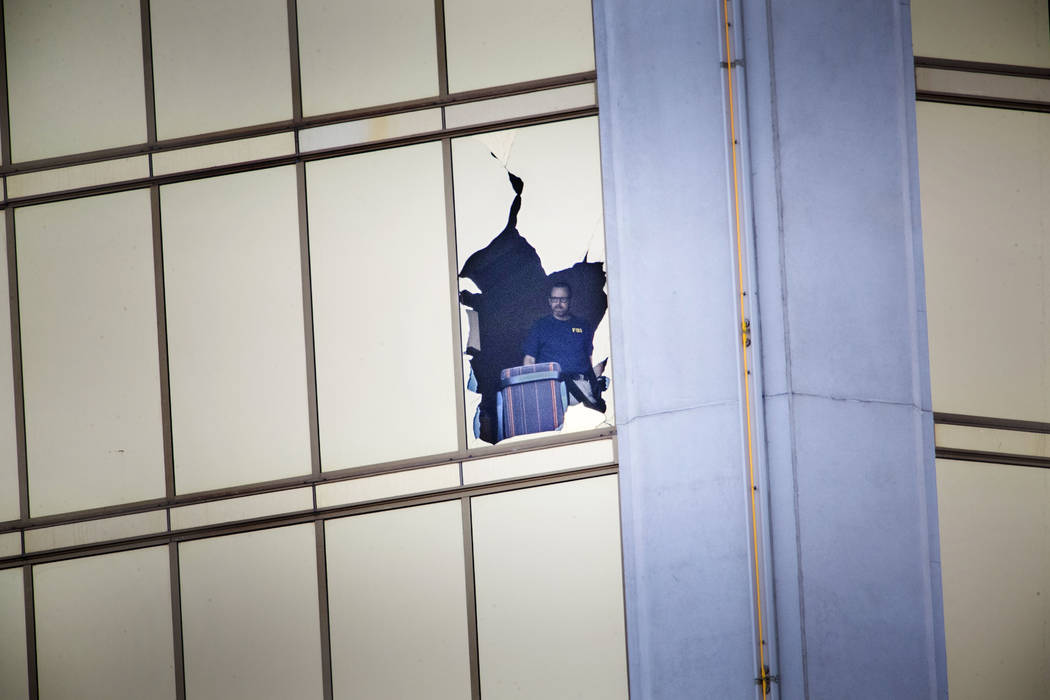 The FBI investigates the scene on the 32nd-floor of the Mandalay Bay hotel-casino on Wednesday, Oct. 4, 2017, in Las Vegas. Richard Brian Las Vegas Review-Journal @vegasphotograph