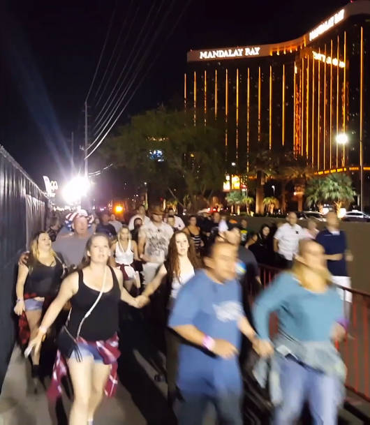 Video frame grab shows people rushing out of the Route 91 Harvest country music festival on the Las Vegas Strip after Stephen Paddock opened gunfire from a Mandalay Bay hotel room on Oct. 1, 2017. ...