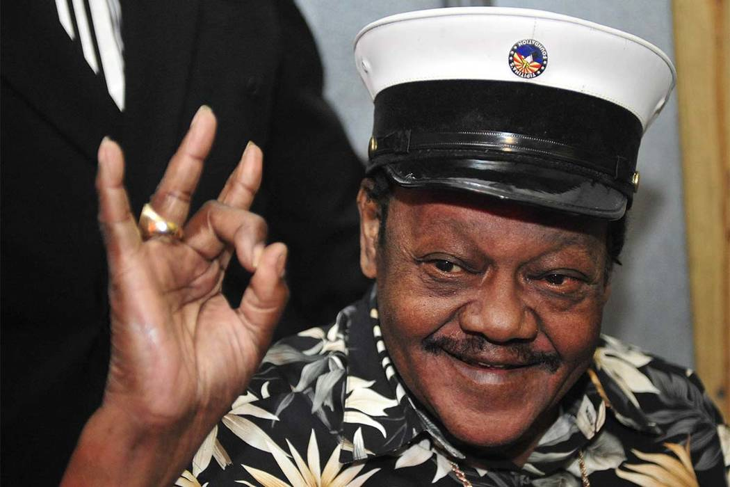 Fats Domino waves to fans before a ceremony to re-present two Grammy awards to replace the ones that he lost from Hurricane Katrina's flooding in New Orleans, Nov. 5, 2008. Domino died Tuesday, Oc ...