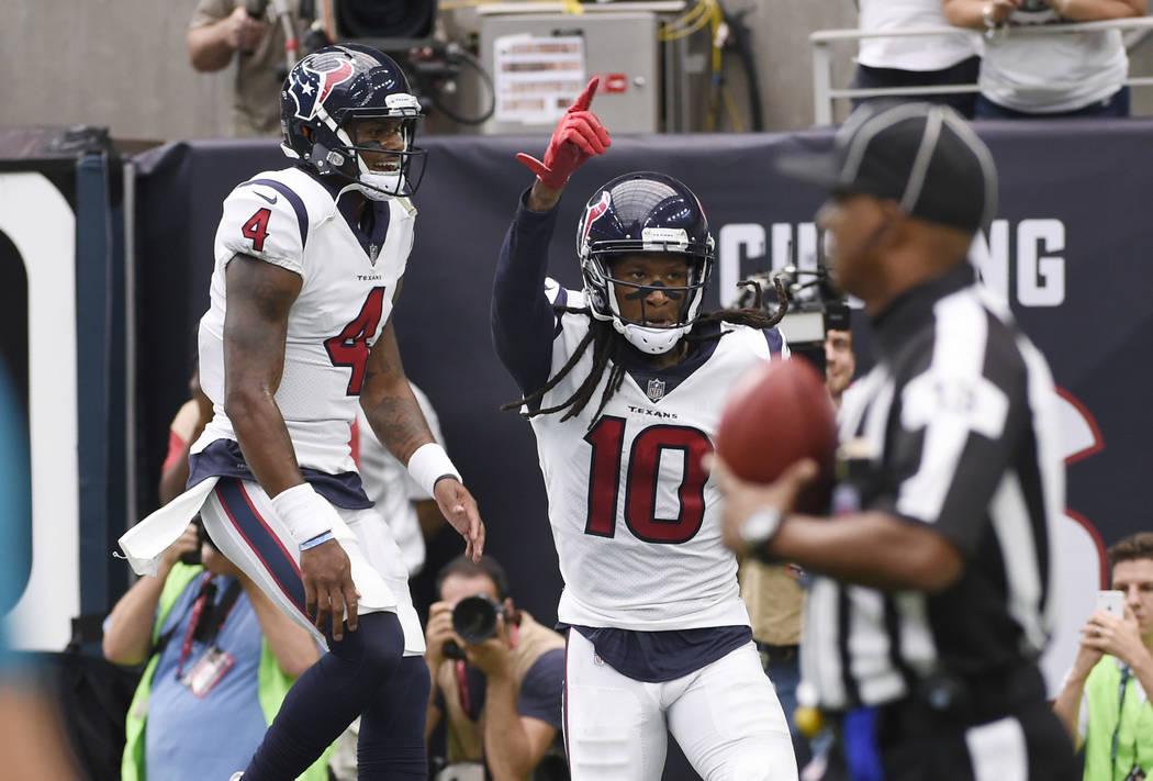 b13755ff Houston Texans quarterback Deshaun Watson (4) celebrates with teammate wide  receiver DeAndre Hopkins (