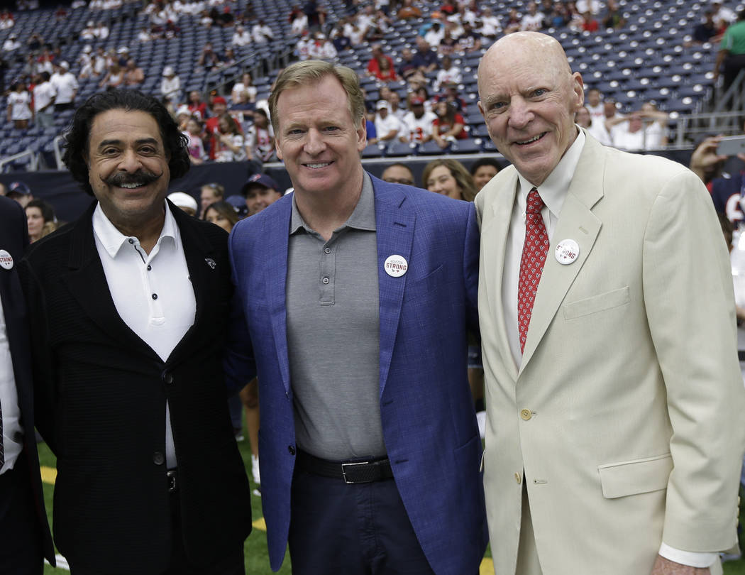 NFL Commissioner Roger Goodell, center, poses with Jacksonville Jaguars owner Shahid Khan, left, and Houston Texans owner Bob McNair, right, prior to an NFL football game Sunday, Sept. 10, 2017, i ...